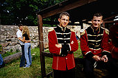 Trakai, Lithuania: young members of a band at a band festival at ruins of the peninsular castle.