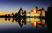Trakai, Lithuania: the insular castle reflexing on Galves lake with 'midnight sun';