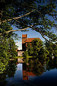 Trakai, Lithuania: the right side of the insular castle (Traku pilis) reflected on the water of the Galves lake;