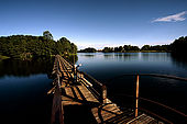 Trakai, Lithuania: fishing on the floating bridge that provides a boarderline between the Galves lake and the Bernardinu lake;