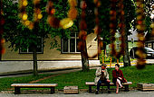 Trakai, Lithuania: people sitting on a bench in Trakai's former main square
