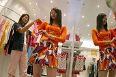 Chinese young women shopping at a boutique in Beijing.
