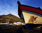 Italy, Sicily, Stromboli island. Painted fishing boat.