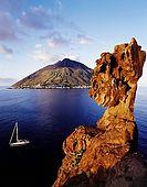 Italy, Sicily, Stromboli island. Stack rock of Strombolicchio  in foreground