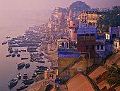 Varanasi's ghats emerging the fog at dawn.