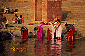 Bathing in the Ganges river at dawn.