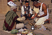 A Brahman practicing a funeral rite to a pilgrim from India's south.
