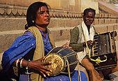 Musicians playing traditional indian songs along Varanasi's ghats.