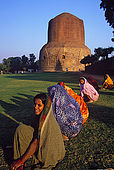 Ladies gardening at the foot of the Dhamekh stupa. The stupa signs the place where the Buddha once started his predication.