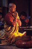 Evening prayer in a Buddhist monastery in the Varanasi's neighborhood of Sarnath, where the Buddha once started his predication.
