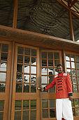 Doorman at the entrance to the Tea Factory Hotel, Nuwara Eliya, Central Province, Sri Lanka