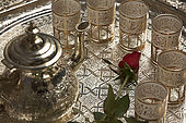 Traditional tea set and rose, interior of traditional Moroccan riad, Fes, Morroco