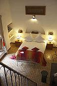 Bedroom interior, Riad Larrousa, traditional Moroccan riad, Fes, Morocco. Property released.