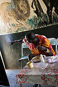 Masai at lunch in the Assam butchery, a meeting place near the Talek Gate of the Masai Mara National Reserve