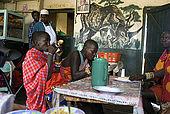 Masai having lunch at the Assam butchery, meeting place near the Talek Gate of the Masai Mara