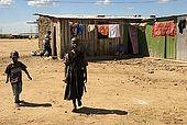 Children walking in Talek village