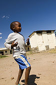 Child playing in Talek village