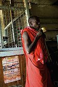 Masai man in the Assam butchery, meeting place near the Talek Gate of the Masai Mara