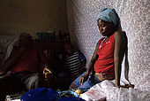 Betty,a Masai guide, and her child at home with Mwura,also a Masai guide, after a day's work in the National Reserve