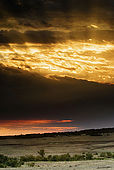 Sunset over the Masai Mara National Reserve after a rainstorm