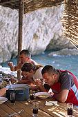 Balkan, Adriatic sea coast    Republic of Montenegro    near Budva Pic nic     on the beach 'Kajanegra'    eating fisherman soup    Model Release OK