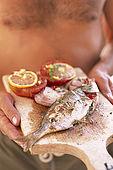 Balkan, Adriatic sea coast    Republic of Montenegro    near Budva Pic nic     on the beach 'Kajanegra'    grilled fish