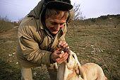 France, Lot, Quercy region dressage d'un chien truffier Pierre Sourzat chercheur auprès de la station trufficole de Cahors Le Montat model release OK