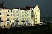 Street of traditional Regency-style buildings - all offering bed and breakfast - on the coast at Brighton during a storm