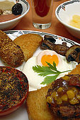 Vegetarian English breakfast at Paskins Hotel including homemade vegetarian sausage made with sun-dried tomatoes, paprika and tarragon.