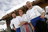 Sergio and Manuela Rossi with their son at Rifugio Fuciade, Trentino, Italy