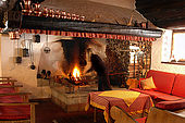 Lounge with large open log fire, Maso Doss, Pinzolo, Trentino, Italy. Tel 0465 502758