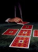 A man dealing tarot cards