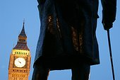 England, London, Westminster. Big Ben framed by a statue of Winston Churchill.