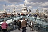 England, London, South Bank. A view across the Millennium Bridge to St Paul's Cathedral.