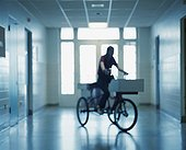 Blurry Woman on Delivery Bike