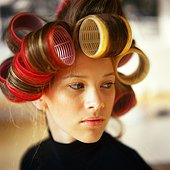 Young woman with rollers in hair