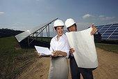 engineers working on solar panel