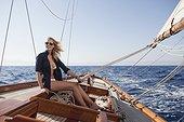 woman smiling steering boat