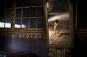 Reflection In A Mirror Of A Young Girl Running Through The House; Tanjung Lubuk Sumatera Selatan Indonesia