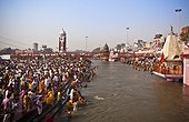 a crowd gathers to bathe at the ganges river for the kumbh mela pilgrimage; haridwar india