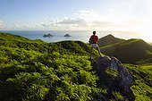 Hawaii, Oahu, Lanikai, Woman hiker admiring view of Mokulua Islands.
