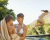 Mother with young son and daughter at swimming pool