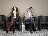 Two businesswomen sitting in waiting room. Brussels, Belgium.