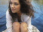 Woman sitting at lake