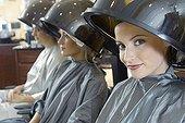 Women sitting under hair dryers
