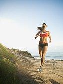 Woman training on coast - USA, California, San Diego