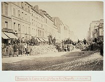 Roger-Viollet | 27207 | Barricade at the entrance of the grand rue de la Chapelle, on March 18, 1871. Anonymous. Plate 170 from the album on the Commune in Paris. Paris, musée Carnavalet. | © Musée Carnavalet / Roger-Viollet