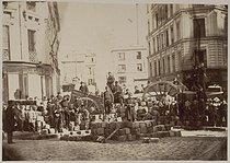 Roger-Viollet | 29792 | Album about the Commune, in 1871. Barricade at the passage Raoul, boulevard Richard Lenoir. Paris, musée Carnavalet. | © Musée Carnavalet / Roger-Viollet