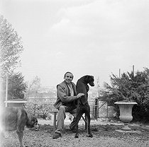 Roger-Viollet | 158505 | Louis-Ferdinand Céline (1894-1961), French writer, with his dogs. Meudon, about 1955. | © Bernard Lipnitzki / Roger-Viollet