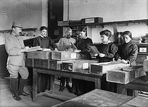 Roger-Viollet | 159660 | World War I. Updating identification-number files in a military mobilisation office, in 1916. | © Jacques Boyer / Roger-Viollet